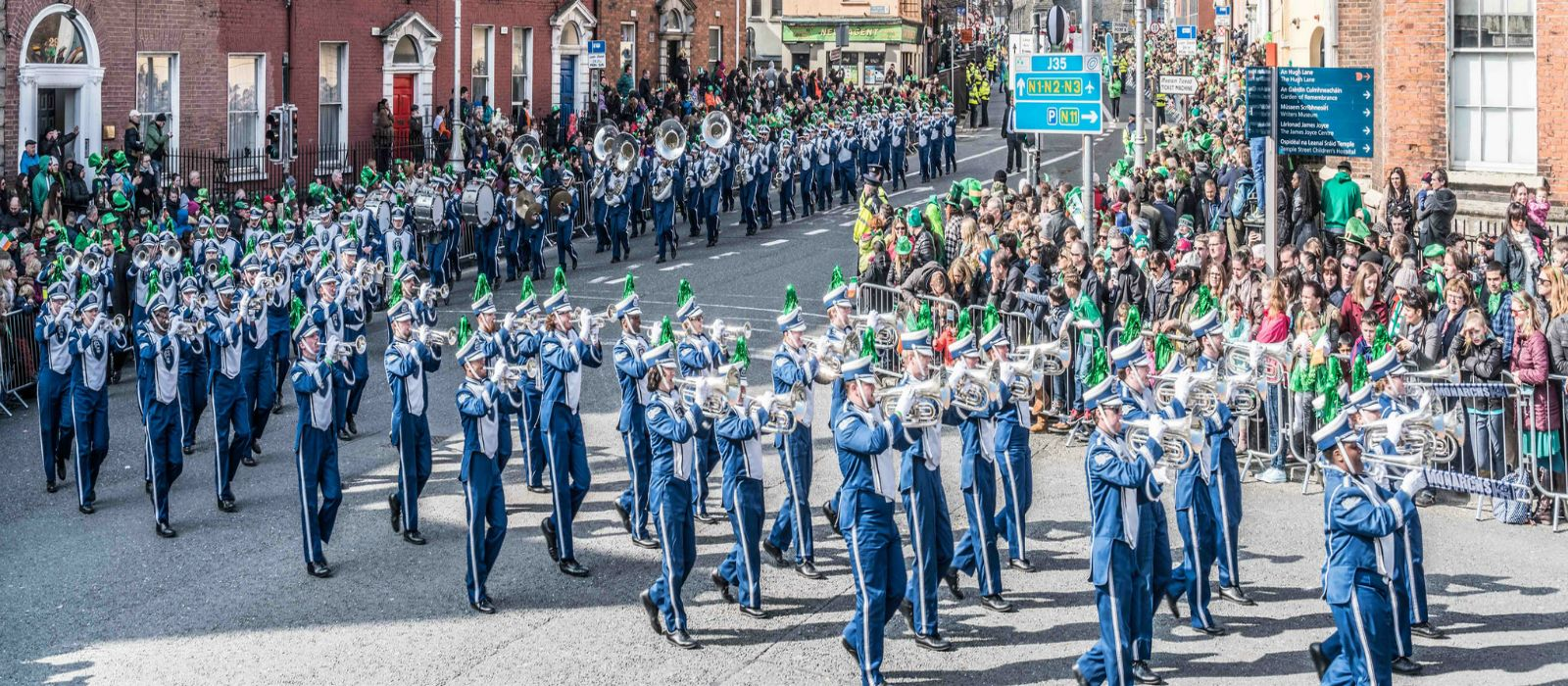Marching band enjoying st.Patrick's day parade on marching band performance tours of Ireland.