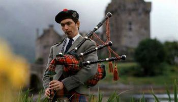 The bagpipes, played in the stunning grounds of Eilean Castle, Scotland.