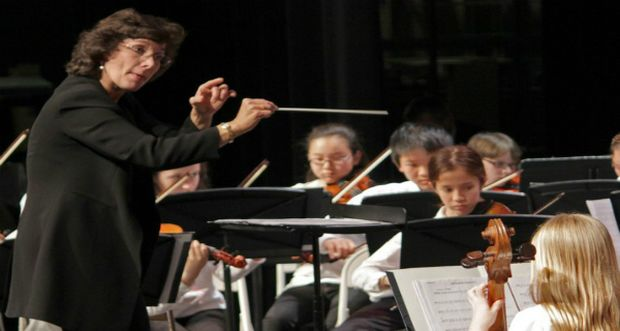 Orchestra conductor on orchestra performance tour