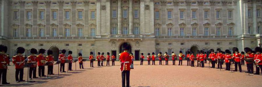 Buckingham Palace, the home of the Queen of England in London, with the famous Royal Guards outside.
