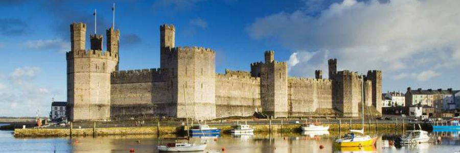 Caernarfon castle is a historic site dominating the town of Caernarfon in Wales.