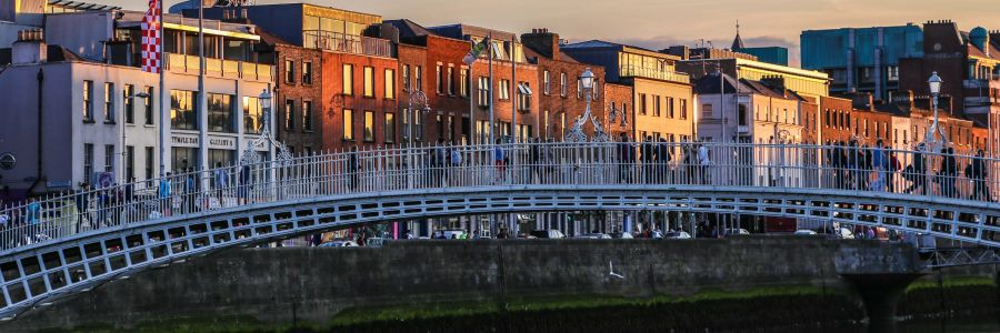 The Ha'Penny Bridge over the Liffey at sunset. Enjoy the iconic sights of Ireland with Discover Ireland Tours.